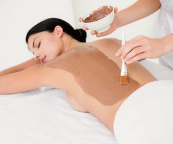 Beautiful brunette enjoying a chocolate beauty treatment at the health